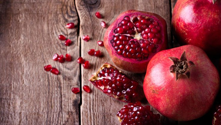 pomegranate fruit tempted by the fruit of another